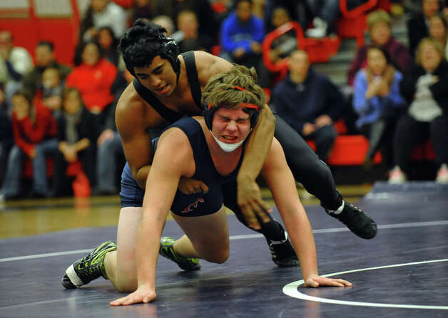 Foran's Luke Edmondson, and Law's Phil Centore, top,  during wrestling action in Milford Conn. on Thursday January 3, 2012. Photo: Christian Abraham / Connecticut Post