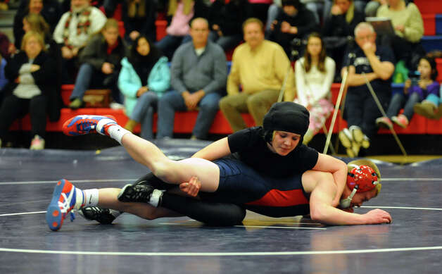 Law's Sam Rehentisch, top, and Foran's Liam Callahan, during wrestling action in Milford Conn. on Thursday January 3, 2012. Photo: Christian Abraham / Connecticut Post
