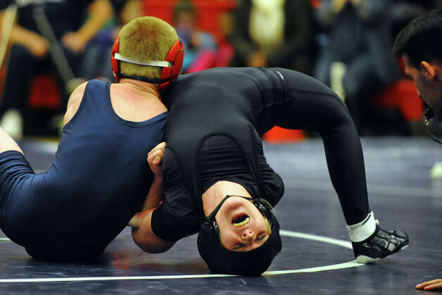 Law's Sam Rehentisch and Foran's Liam Callahan, left, during wrestling action in Milford Conn. on Thursday January 3, 2012. Photo: Christian Abraham / Connecticut Post