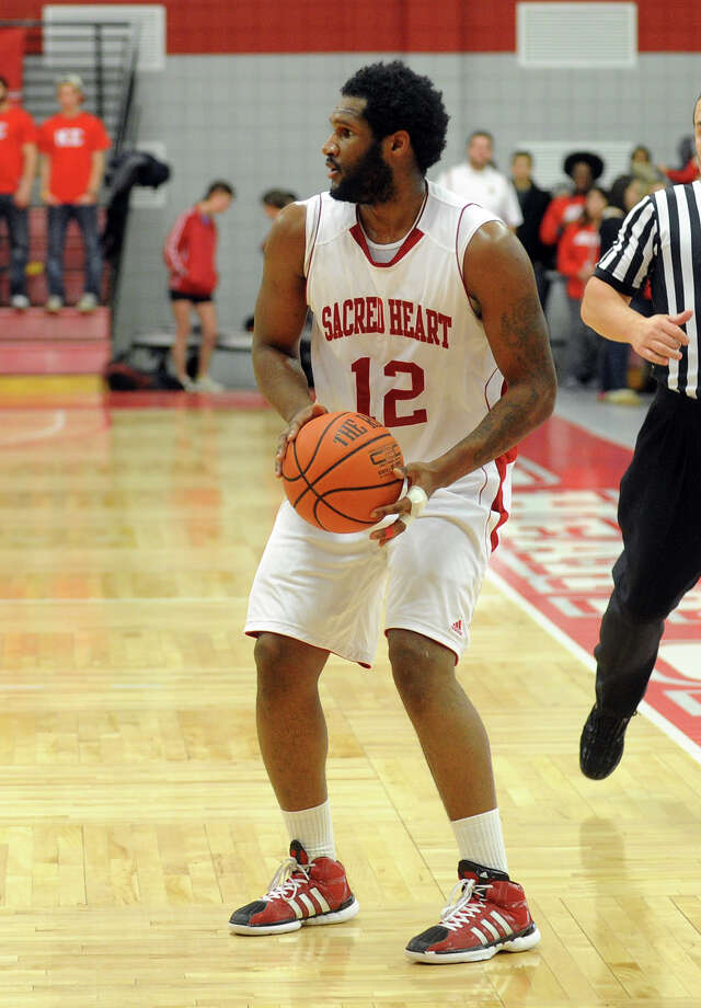 Louis Montes scored a career-high 35 points to lead Sacred Heart past Long Island Brooklyn, which won the NEC title the past two seasons. Photo: Christian Abraham / Connecticut Post