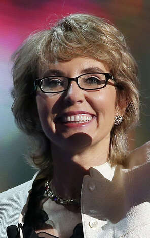 CHARLOTTE, NC - SEPTEMBER 06:  Former U.S. Rep. Gabrielle Giffords (D-NV) waves on stage during the final day of the Democratic National Convention at Time Warner Cable Arena on September 6, 2012 in Charlotte, North Carolina. The DNC, which concludes today, nominated U.S. President Barack Obama as the Democratic presidential candidate.  (Photo by Chip Somodevilla/Getty Images)  *** BESTPIX *** Photo: Chip Somodevilla, Getty Images / 2012 Getty Images