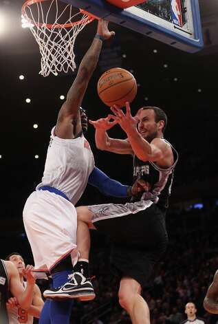 Amar'e Stoudemire (left) of the Knicks fouls Manu Ginobili of the Spurs late in the game at Madison Square Garden on Jan. 3, 2013 in New York City. Photo: Bruce Bennett, Getty Images / 2013 Getty Images