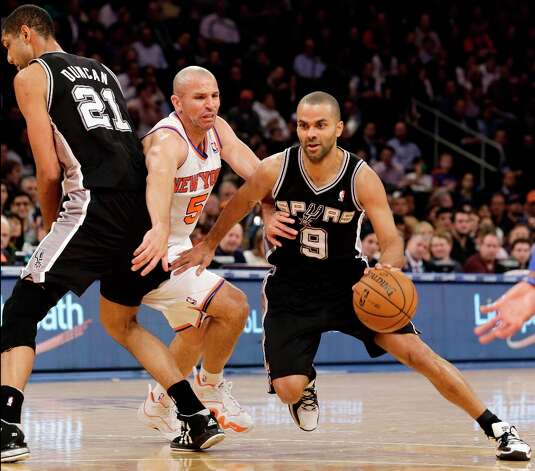 Knicks guard Jason Kidd (5) is sandwiched between Spurs forward Tim Duncan (21) and guard Tony Parker (9) as Parker drives to the basket in the first half in New York, Thursday, Jan. 3, 2013. Photo: Kathy Willens, Associated Press / AP