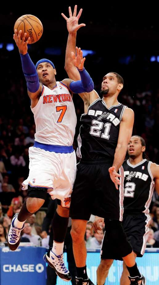 Knicks forward Carmelo Anthony (7) shoots a layup against Spurs forward Tim Duncan (21) in the second half in New York, Thursday, Jan. 3, 2013. Photo: Kathy Willens, Associated Press / AP