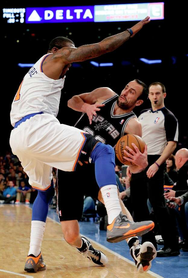 Spurs guard Manu Ginobili (20) tries to stay in bounds as he passes around Knicks forward Amare Stoudemire (1) in the first half in New York, Thursday, Jan. 3, 2013. Photo: Kathy Willens, Associated Press / AP