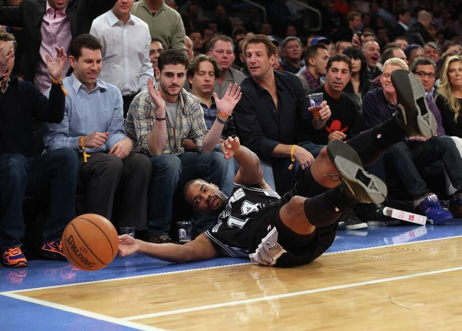 Gary Neal (14) of the Spurs tries to keep the ball in play during the first quarter against the Knicks on Jan. 3, 2013 in New York City. Photo: Bruce Bennett, Getty Images / 2013 Getty Images