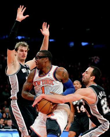 Spurs guard Manu Ginobili (20) defends against Knicks forward Amare Stoudemire (1) in the second half in New York, Thursday, Jan. 3, 2013. The Knicks won 100-83. Photo: Kathy Willens, Associated Press / AP