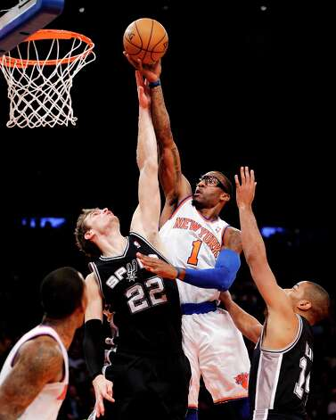 Spurs forward Tiago Splitter (22) and guard Gary Neal (14) defend against Knicks forward Amare Stoudemire (1) in the second half in New York, Thursday, Jan. 3, 2013. Photo: Kathy Willens, Associated Press / AP