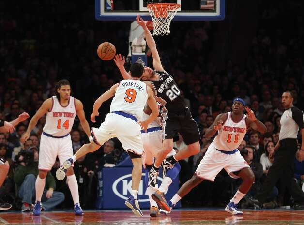 Pablo Prigioni (9) of the Knicks knocks the ball out of the hands of Manu Ginobili (20) of the Spurs on Jan. 3, 2013 in New York City. Photo: Bruce Bennett, Getty Images / 2013 Getty Images
