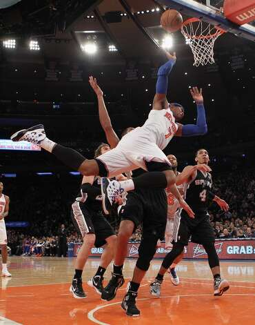 Carmelo Anthony (7) of the Knicks scores in the second quarter against the Spurs on Jan. 3, 2013 in New York City. Photo: Bruce Bennett, Getty Images / 2013 Getty Images