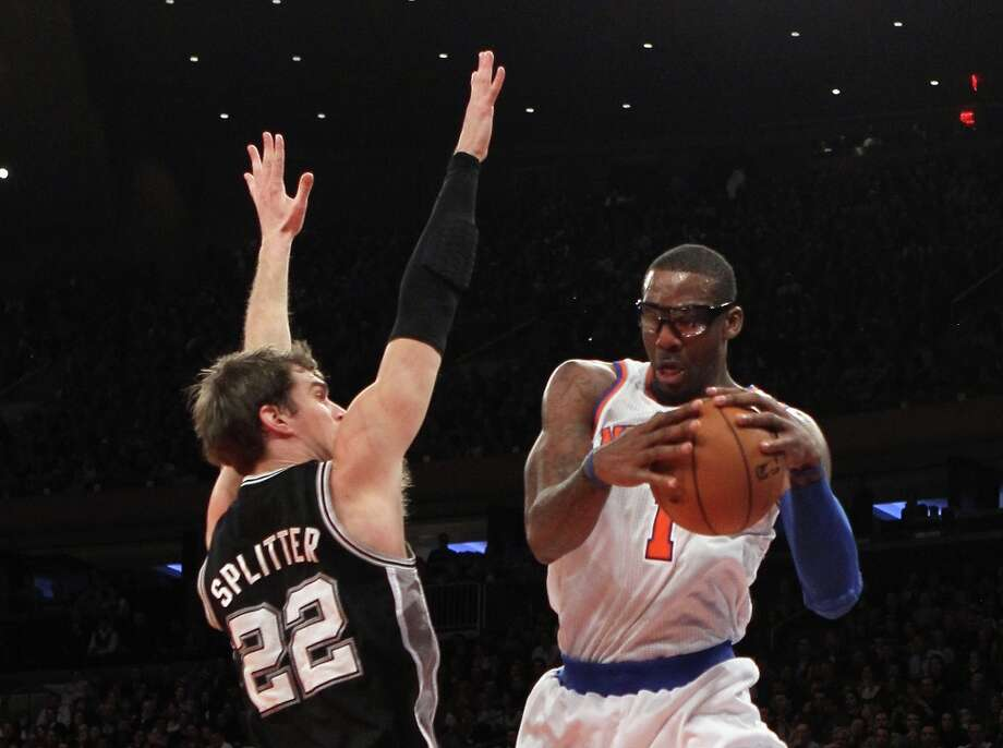 Tiago Splitter (22) of the Spurs attempts to block a pass from Amar'e Stoudemire (1) of the Knicks on Jan. 3, 2013 in New York City. Photo: Bruce Bennett, Getty Images / 2013 Getty Images