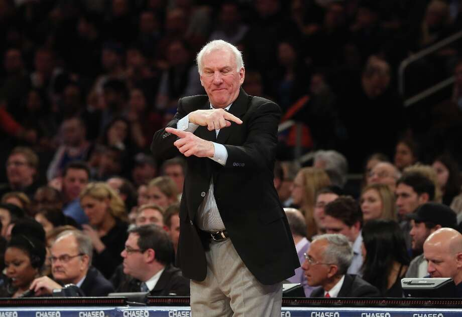 Spurs coach Gregg Popovich gives his team instructions during the game against the Knicks at Madison Square Garden on Jan. 3, 2013 in New York City. Photo: Bruce Bennett, Getty Images / 2013 Getty Images