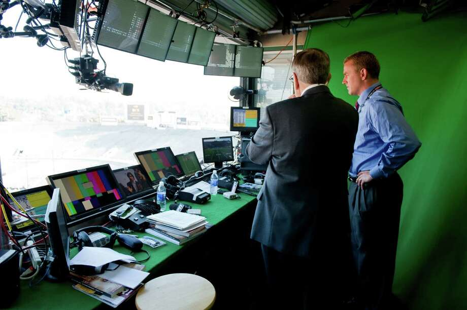 Brent Musburger (left) and Kirk Herbstreit will call the BCS National Championship game for ESPN. (Courtesy ESPN) Photo: Joe Faraoni / (c) 2010 ESPN, Inc.  All rights reserved.  For editorial purposes only.  NO ARCHIVING, NO RESALE.