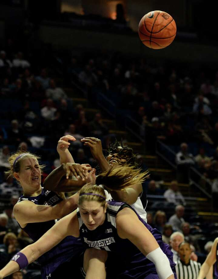 Penn State's Nikki Greene, top right, collides with a pair of Northwestern defenders during the first half of an NCAA college basketball game in State College, Pa., Thursday, Jan. 3, 2013. (AP Photo/Ralph Wilson) Photo: Ralph Wilson