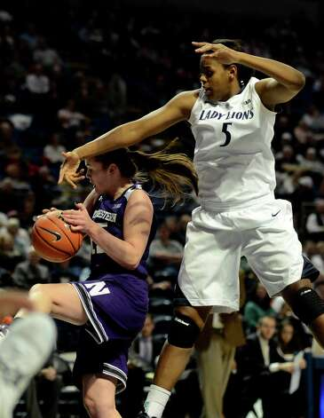 Northwestern's Maggie Lyon. left, pulls in a rebound around Penn State's Talia East (5) during the first half of an NCAA college basketball game in State College, Pa., Thursday, Jan. 3, 2013. (AP Photo/Ralph Wilson) Photo: Ralph Wilson