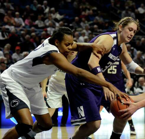 Penn State's Talia East, left, reaches for a rebound around Northwestern's Dannielle Diamant (31) during the first half of an NCAA college basketball game in State College, Pa., Thursday, Jan. 3, 2013. (AP Photo/Ralph Wilson) Photo: Ralph Wilson