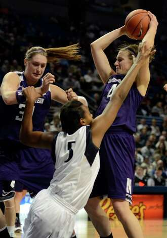 Penn State's Talia East (5) reaches for a rebound around Northwestern's Dannielle Diamant (31) and Kendall Hackney (4) during the first half of an NCAA college basketball game in State College, Pa., Thursday, Jan. 3, 2013. (AP Photo/Ralph Wilson) Photo: Ralph Wilson