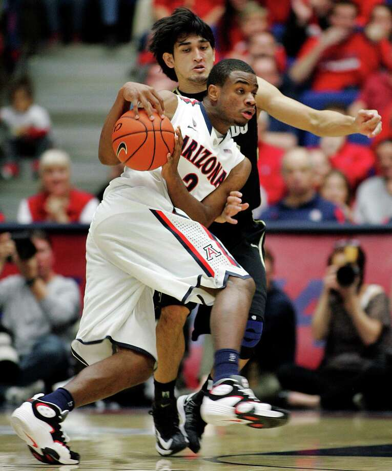 Arizona's Kevin Parrom (3) drives against Colorado's Sabatino Chen during the second half of an NCAA college basketball game at McKale Center in Tucson, Ariz., Thursday, Jan 3, 2013. Arizona won 92-83 in overtime. (AP Photo/John Miller) Photo: JOHN MILLER