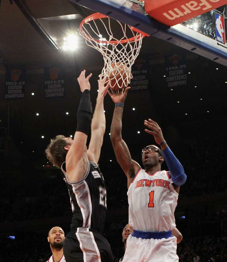 NEW YORK, NY - JANUARY 03:  Amar'e Stoudemire #1 of the New York Knicks scores two in the first quarter against the San Antonio Spurs at Madison Square Garden on January 3, 2013 in New York City. NOTE TO USER: User expressly acknowledges and agrees that, by downloading and/or using this photograph, user is consenting to the terms and conditions of the Getty Images License Agreement.  (Photo by Bruce Bennett/Getty Images) Photo: Bruce Bennett