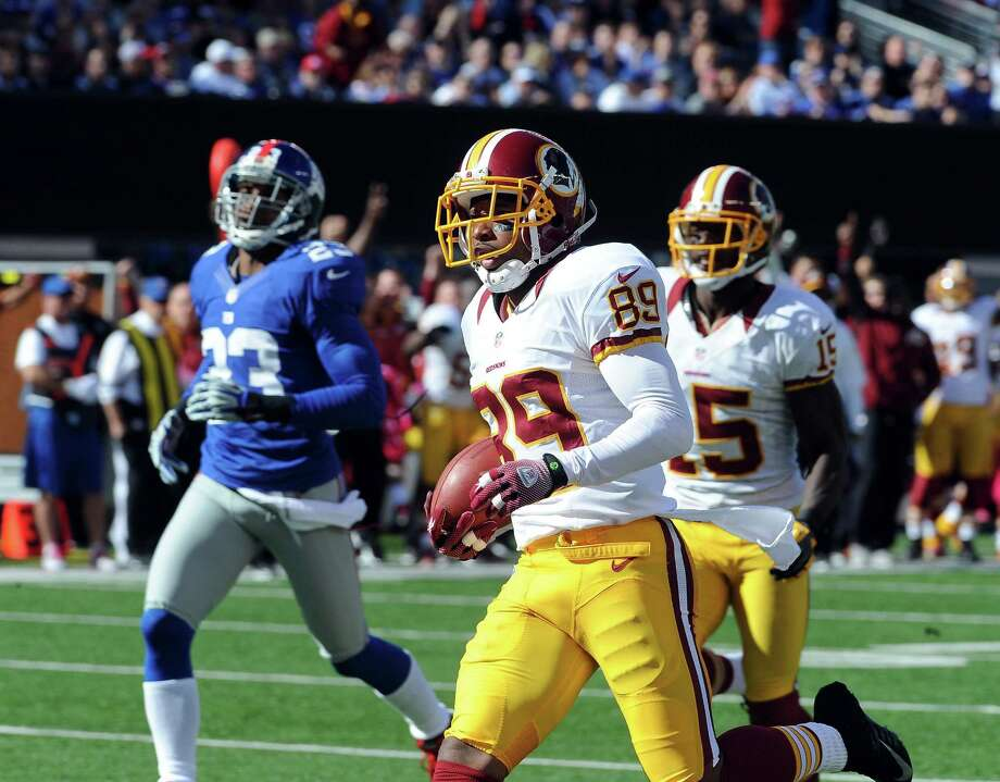 Washington Redskins wide receiver Santana Moss (89) runs for a touchdown in the first half of an NFL game against the New York Giants at MetLife Stadium in East Rutherford, N.J., Oct. 21, 2012. (Barton Silverman/The New York Times) Photo: BARTON SILVERMAN / NYTNS
