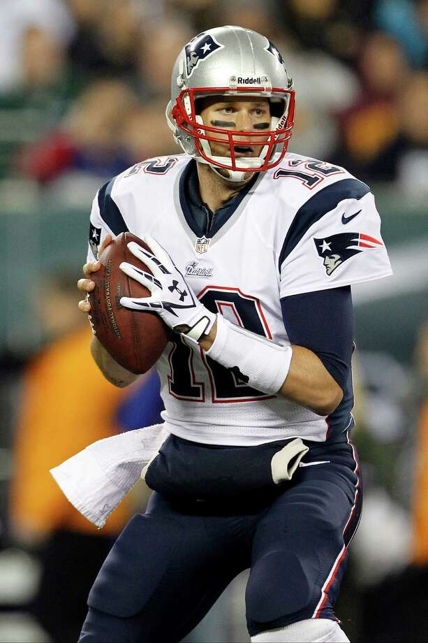 New England Patriots quarterback Tom Brady (12) looks to pass during the first half of an NFL football game against the New York Jets, Thursday, Nov. 22, 2012, in East Rutherford, N.J. (AP Photo/Julio Cortez) Photo: Julio Cortez / AP