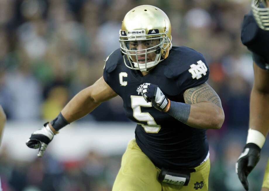 FILE - In this Oct. 20, 2012, file photo, Notre Dame linebacker Manti Te'o chases the action during the second half of an NCAA college football game against the BYU in South Bend, Ind.  Alabama's Barrett Jones and Notre Dame's Te'o are All-Americans and national award winners. They're also fine students who emphasize faith and postponed big money from the NFL to stay in school.(AP Photo/Michael Conroy, File) Photo: Michael Conroy