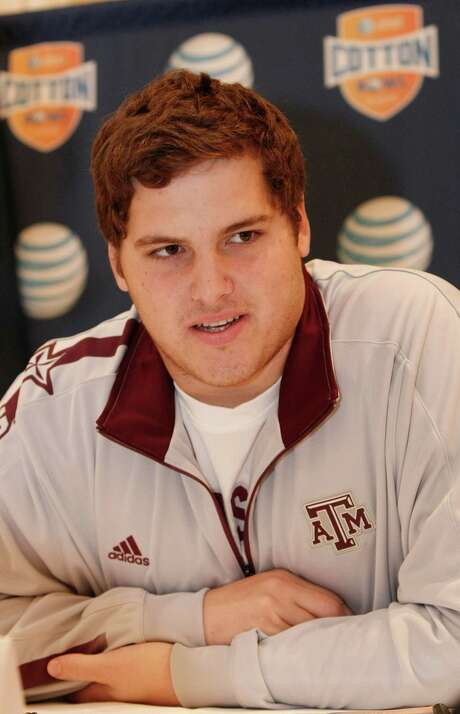 Texas A&M junior offensive lineman Luke Joeckel answers questions during a press conference for the Cotton Bowl NCAA college football at the Omni Mandalay hotel, Tuesday, Jan. 1, 2013, in Irving, Texas. Texas A&M plays Oklahoma on Jan. 4 in the Cotton Bowl in Arlington, Texas. (AP Photo/Brandon Wade) Photo: Brandon Wade, FRE / FR168019 AP