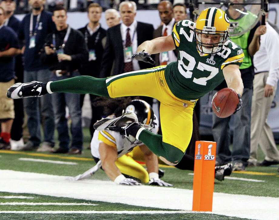 Jordy Nelson nearly scores on one of his nine catches in Super Bowl XLV, in which the Packers beat the Steelers to complete a title run as a wild-card team. Photo: Tom Fox / Dallas Morning News