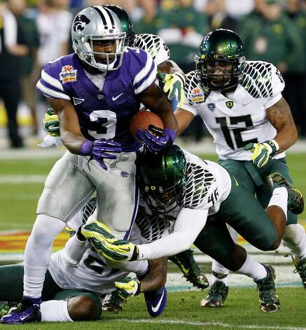 Kansas State wide receiver Chris Harper (3) is tackled by Oregon linebacker Michael Clay (46) during the first half of the Fiesta Bowl NCAA college football game, Thursday, Jan. 3, 2013, in Glendale, Ariz. (AP Photo/Ross D. Franklin) Photo: Ross D. Franklin