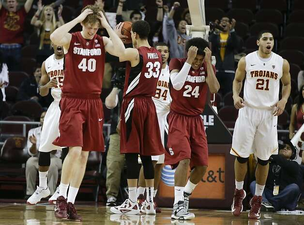 Stanford's John Gage, from left, Dwight Powell and Josh Huestis react to their loss as Southern California forward Aaron Fuller celebrates after an NCAA college basketball game in Los Angeles, Thursday, Jan. 3, 2013. USC won 71-69. (AP Photo/Chris Carlson) Photo: Chris Carlson, Associated Press