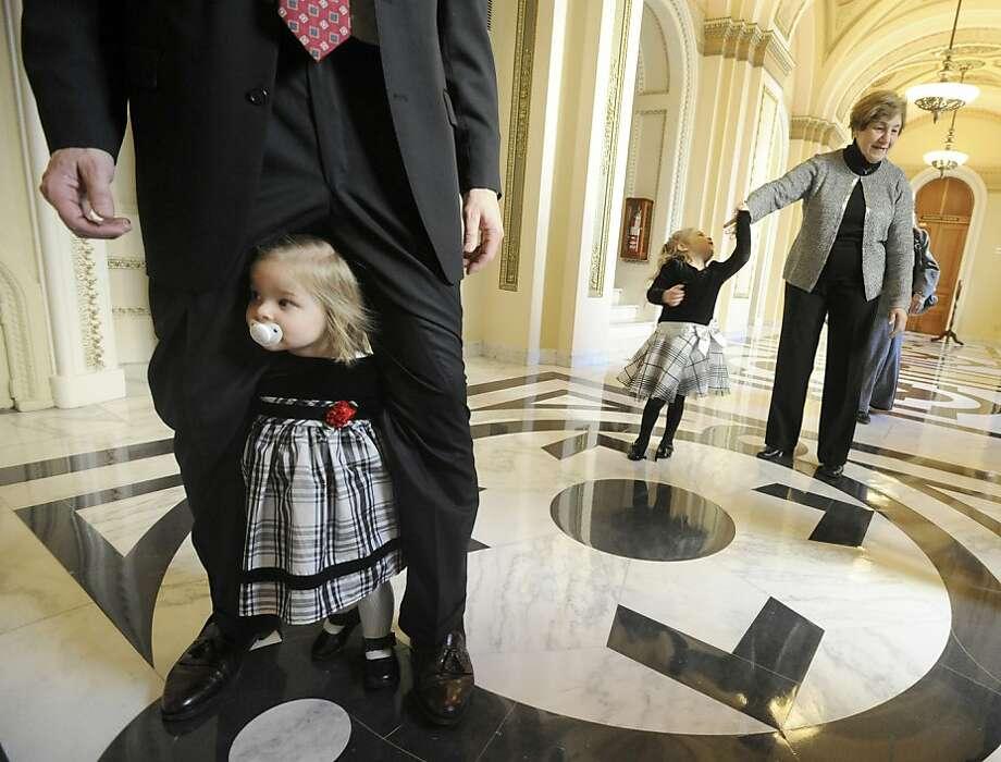 Rep. Scott Perry's 20-month-old daughter Mattea walks through his legs while they wait to have their photo taken after he had taken his oath of office in Washington on Thursday, Jan. 3, 2012. Photo: Jason Plotkin, Associated Press
