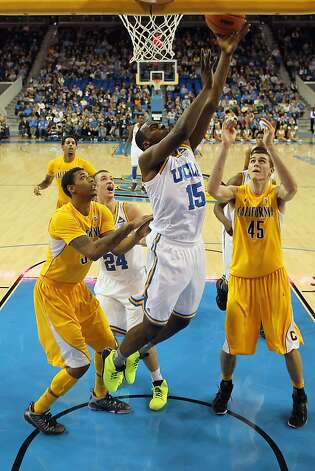 LOS ANGELES, CA - JANUARY 03:  Shabazz Muhammad #15 of the UCLA Bruins pulls down a rebound between Richard Solomon (L) #35 and David Kravish #45 of the California Golden Bears in the first half at Pauley Pavilion on January 3, 2013 in Los Angeles, California.  (Photo by Jeff Gross/Getty Images) Photo: Jeff Gross, Getty Images