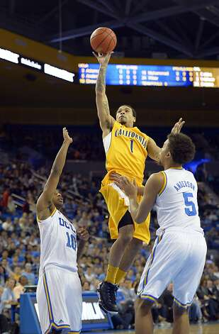 California guard Justin Cobbs, center, puts up a shot as UCLA guard Larry Drew II, left, and guard Kyle Anderson defend during the first half of their NCAA basketball game, Thursday, Jan. 3, 2013, in Los Angeles. (AP Photo/Mark J. Terrill) Photo: Mark J. Terrill, Associated Press