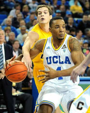 California's Ricky Kreklow tries to steal the ball away from UCLA's Norman Powell (4) in the first half at Pauley Pavillion in Los Angeles, California, on Thursday, January 3, 2013. (Wally Skalij/Los Angeles Times/MCT) Photo: Wally Skalij, McClatchy-Tribune News Service