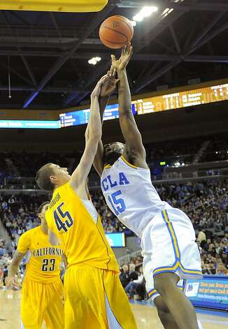 UCLA forward Shabazz Muhammad, right, is fouled by California forward David Kravish during the first half of their NCAA basketball game, Thursday, Jan. 3, 2013, in Los Angeles. (AP Photo/Mark J. Terrill) Photo: Mark J. Terrill, Associated Press