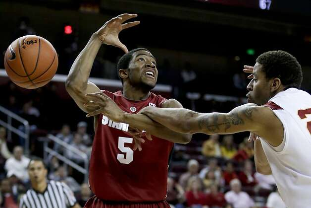Stanford guard Chasson Randle, left, is fouled by Southern California guard J.T. Terrell during the first half of an NCAA college basketball game in Los Angeles, Thursday, Jan. 3, 2013. (AP Photo/Chris Carlson) Photo: Chris Carlson, Associated Press