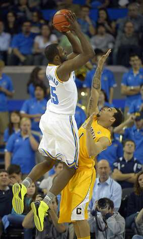 UCLA forward Shabazz Muhammad, left, puts up a shot as California guard Justin Cobbs defends during the first half of their NCAA basketball game, Thursday, Jan. 3, 2013, in Los Angeles. (AP Photo/Mark J. Terrill) Photo: Mark J. Terrill, Associated Press
