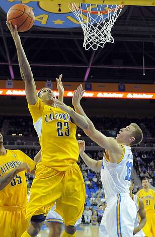 California guard Allen Crabbe, left, puts up a shot as UCLA forward David Wear defends during the second half of their NCAA basketball game, Thursday, Jan. 3, 2013, in Los Angeles. UCLA won 79-65. (AP Photo/Mark J. Terrill) Photo: Mark J. Terrill, Associated Press