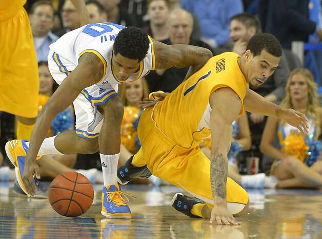 UCLA guard Larry Drew II, left, and California guard Justin Cobbs battle for a loose ball during the second half of their NCAA basketball game, Thursday, Jan. 3, 2013, in Los Angeles. UCLA won 79-65. (AP Photo/Mark J. Terrill) Photo: Mark J. Terrill, Associated Press