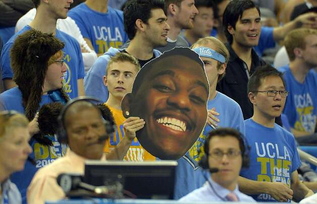 A fan holds up a large picture of UCLA forward Shabazz Muhammad during the second half of their NCAA basketball game against California, Thursday, Jan. 3, 2013, in Los Angeles. UCLA won 79-65. (AP Photo/Mark J. Terrill) Photo: Mark J. Terrill, Associated Press