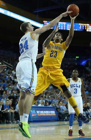 LOS ANGELES, CA - JANUARY 03:  Allen Crabbe #23 of the California Golden Bears is defended by Travis Wear #24 of the UCLA Bruins in the first half at Pauley Pavilion on January 3, 2013 in Los Angeles, California. UCLA defeated Cal 79-65.  (Photo by Jeff Gross/Getty Images) Photo: Jeff Gross, Getty Images