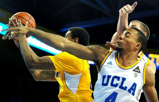 UCLA's Norman Powell (4) gets hit in the head by teammate Travis Wear as they battle for a rebound with Cal's Richard Soloman in the second half at Pauley Pavillion in Los Angeles, California, on Thursday, January 3, 2013. UCLA won, 79-65. (Wally Skalij/Los Angeles Times/MCT) Photo: Wally Skalij, McClatchy-Tribune News Service