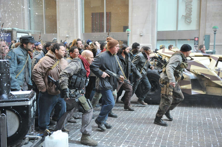 Bad Guys on Wall Street  Filming of the Batman movie The Dark Knight Rises at  Wall Street & Williams St NYC Photo: RICHARD CORKERY, NEW YORK DAILY NEWS / New York Daily News
