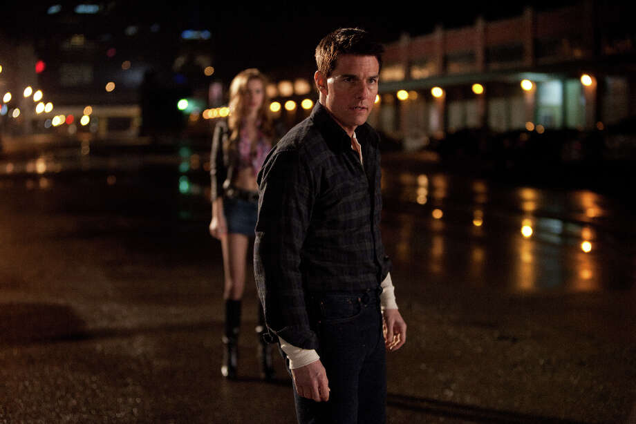Karen Ballard/Paramount Pictures Tom Cruise (front) is Reacher and Alexia Fast (rear) is Sandy in JACK REACHER, from Paramount Pictures and Skydance Productions. Photo: Photo Credit: Karen Ballard, Karen Ballard / © MMXII Paramount Pictures Corporation.   All Rights Reserved.