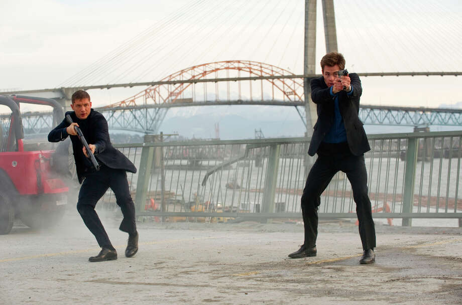In this film image released by 20th Century Fox, Tom Hardy, left, and Chris Pine are shown in a scene from This Means War. (AP Photo/20th Century Fox, Kimberley French) Mick LaSalle has said this film, Rated PG-13, was a missive from a horrible place, a still-fictional but possible future world in which bullying is lovable, brutality is sport, and power is free to rampage; in which people are not human but sub-human, smiling, craving veneers without souls. But the creepiest thing about the movie was that no one, either in front or behind the camera, noticed it was creepy. To all concerned, this was just a jolly romantic comedy. Photo: Kimberley French, AP / TM and © 2012 Twentieth Century Fox Film Corporation. All rights