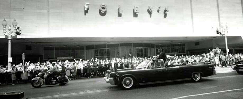 John F. Kennedy's motorcade passes by Foley's during a 1962 visit. (Chronicle file)