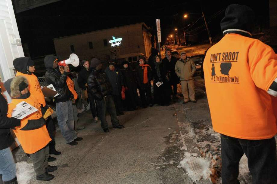 Albany SNUG/CeaseFire hostsed an anti-violence rally Thursday evening Jan. 3, 2013, in response to a New Year?s Day shooting at Sherman Street and Henry Johnson Boulevard in Albany, N.Y. (Michael P. Farrell/Times Union) Photo: Michael P. Farrell