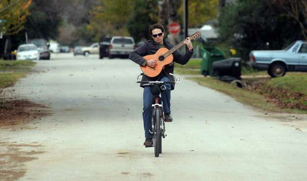 Ian Tomsic plays a little Rush on his guitar while riding to a friend's home in the Heights Thursday Jan. 03, 2013.(Dave Rossman/For the Chronicle) Photo: Dave Rossman, For The Houston Chronicle / © 2012 Dave Rossman