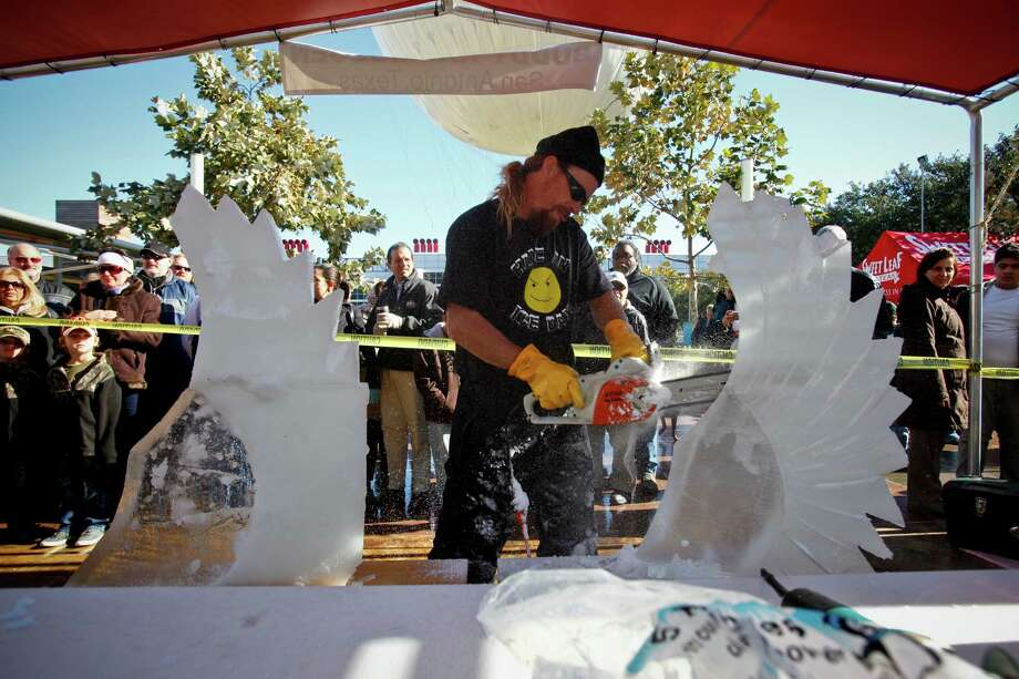 Buddy Rasmussen of the Team Texas Chainsaw Massacre uses a chainsaw to sculpt wings out of ice blocks during the Magnificent Seven All Out Ice Sculpting Competition at Discovery Green Saturday, Jan. 9, 2010, in Houston.