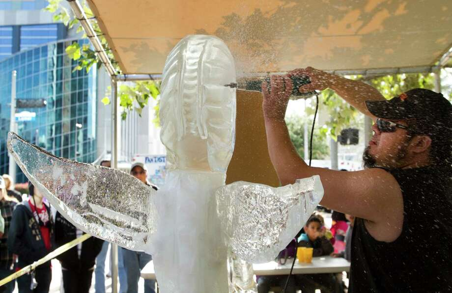 "Julio ""Ice Crush"" Martinez works on his sculpture In Human Form during the 3rd Annual Magnificent Seven All Out Ice Sculpting Competition at Discovery Green Saturday, Jan. 8, 2011, in Houston. Photo: Brett Coomer, Houston Chronicle / Houston Chronicle"